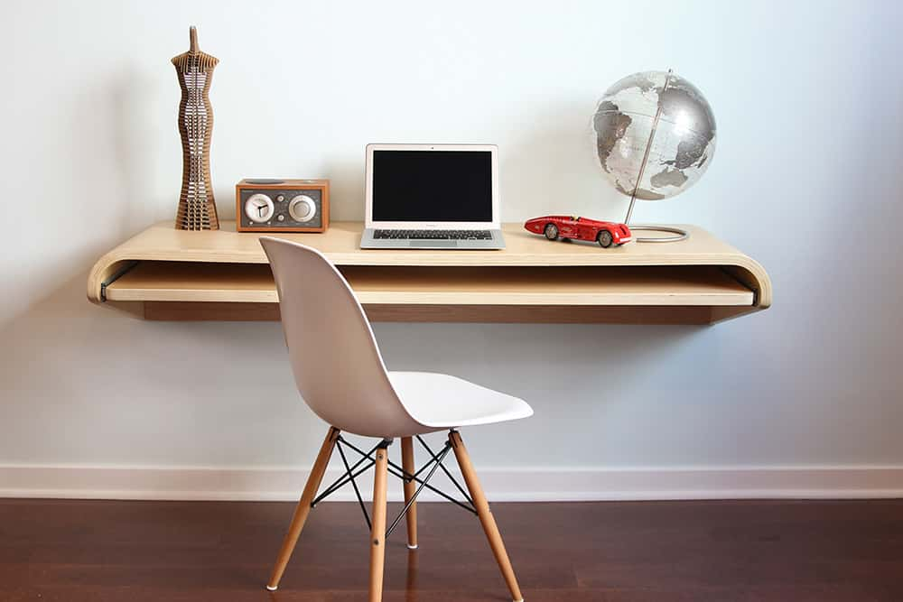 Floating Desk with a Roll out Shelf